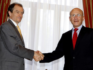 U.S. Assistant Secretary of State Daniel Fried shakes hands with Turkish Cypriot leader Mehmet Ali Talat in Nicosia