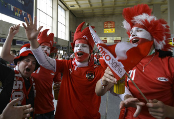 Austria soccer fans sing upon their arrival in Vienna