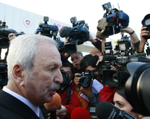 Alemdaroglu is surrounded by the media as he arrives at the heavily guarded Silivri prison, west of Istanbul
