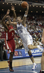 Orlando Magic forward Hedo Turkoglu of Turkey shoots over Atlanta Hawks forward Josh Smith during first half NBA action in Orlando