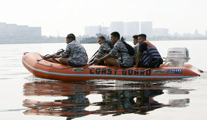 Member of the Philippine Navy Special Operations Group ride on a boat to secure the waters off Manila Bay