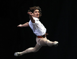 "Argentine ballet dancer Julio Bocca performs in ""The Corsair"" during his farewell performance at an open-air stage in Buenos Aires"