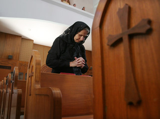 Iraqi Christian woman prays while attending Sunday service at a Baghdad church.
