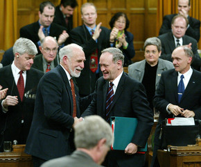 CANADIAN ENVIRONMENT MINISTER ANDERSON IS CONGRATULATED AFTER VOTING ONKYOTO ACCORD.