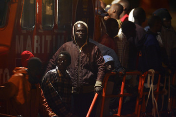 Would-be immigrants wait aboard a rescue ship at the port of Los Cristianos on Spain's Canary island of Tenerife