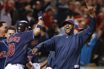 Cleveland Indians Sabathia celebrates with team mate Shoppach as Blake hits a game winning home run to beat the Detroit Tigers