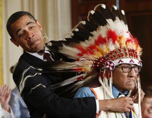 U.S. President Barack Obama presents the Medal of Freedom to Joe Medicine Crow - High Bird during a ceremony in Washington