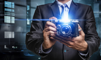 Man with camera in hands