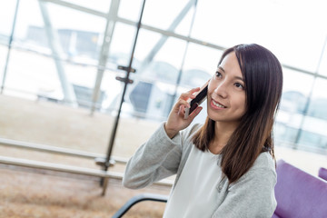 Woman talk to mobile phone in airport