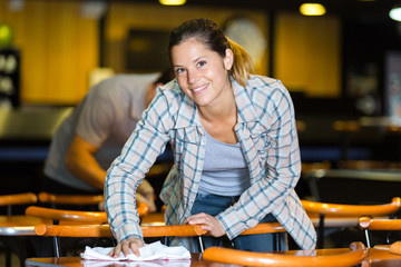 portrait of woman cleaning tables in leisure center