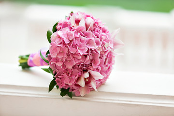 Beautiful blossoming pink hydrangea and orchids in weddin bouquet