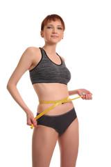 tape measure around woman waist