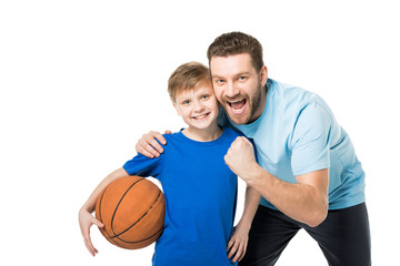 father and child ready to play basketball and looking at camera isolated on white