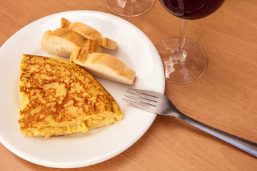 Spanish tortilla with wine, tapas in Madrid bar