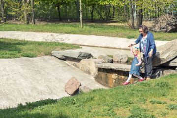 Young woman and little girl playing in spring park. Happy mother and daughter.
