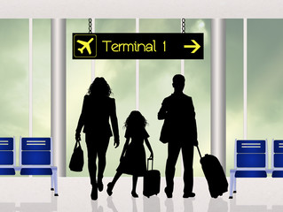 family at the terminal in airport