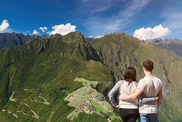 Young couple looking on machu picchu