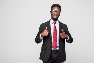 Smiling happy african black executive professional giving a thumbs up in studio