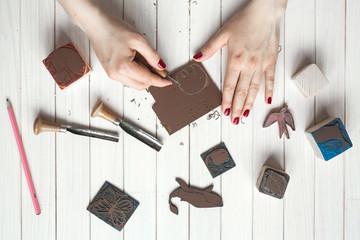 Manual work and creativity closeup hands cut stamp