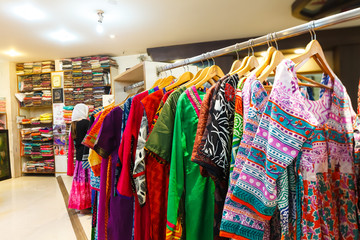 Bright colorful women's clothing in the Indian store Gangotri, Vrindavan.