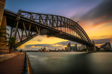 Fototapete - Sunset skyline of Sydney downtown  with Harbour Bridge, NSW, Australia