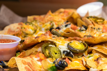 Large nacho plate smothered with cheese and jalapeno peppers. Served with salsa and sour cream.