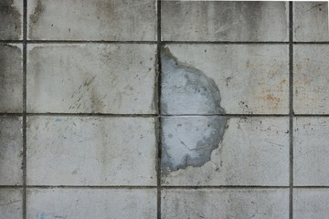 Old concrete wall crack repair