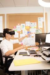 Creative designer experiencing vr glasses
