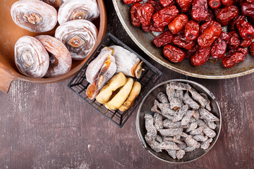 Dried fruits - persimmon, figs, red dates or jujube and salted sliced plum.
