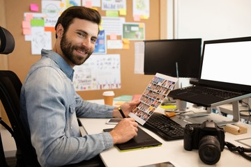 Professional designer working at desk in creative office
