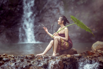 The girl was bathing brook,woman washing in the stream,country girl portrait in outdoors,beautiful happy Asian girl smile and laugh together.