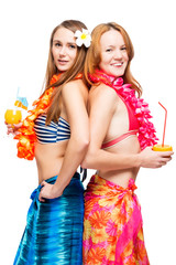 Two young girlfriends in bikini in Hawaiian image with cocktails on white background