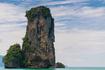 High cliff sticks out from the Andaman Sea near the resort of Krabi, Thailand Wall mural