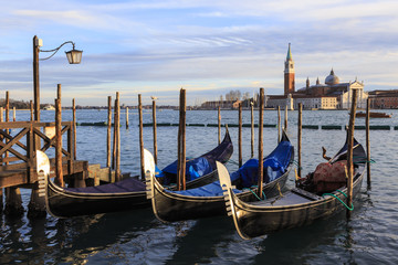 Gondolas, San Marco waterfront at sunset in winter, view to San Giorgio Maggiore, Venice, UNESCO World Heritage Site, Veneto, Italy, Europe