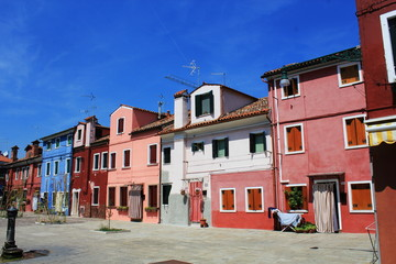 Street with colorful buildings in Burano island, Venice, Italy.