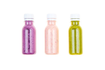 Three types of smoothies in plastic bottles
