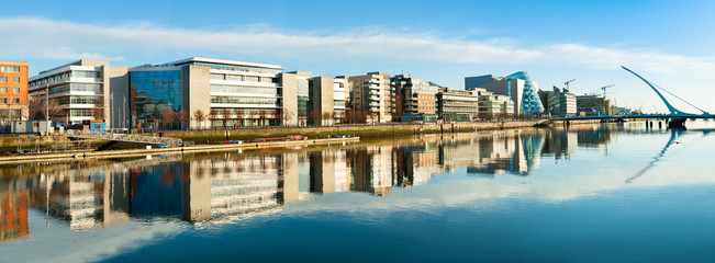 Modern buildings and offices on Liffey river in Dublin, panoramic image