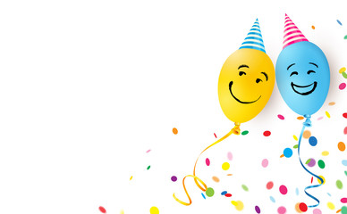 Two funny smiling ballons with caps and confetti celebrating