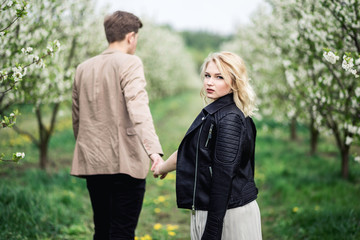 Young couple standing and holding hands