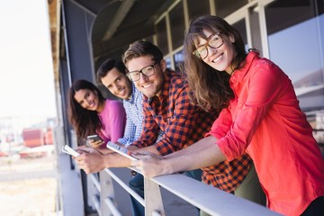 Portrait of smiling business colleagues in balcony