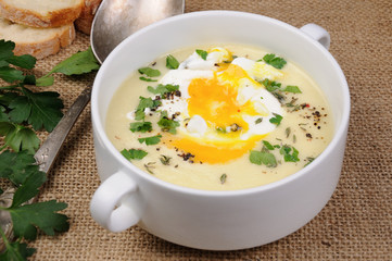 potato cream soup with poached eggs
