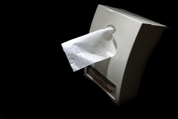Clean and white napkin in white box with dark background.