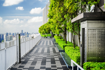Rooftop garden in Singapore. Outside terrace with scenic park