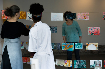 Women looking at marbled prints 1