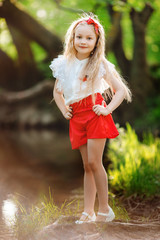 Beautiful child girl outdoors near river