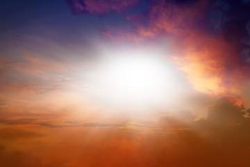 Bright sun in dark sky . Sunset sky . Divine light in clouds . Faith in God. colourful sky . Dramatic sky . Light in dark sky