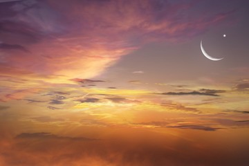 Sunset and new moon . Red sunset and moon . Eid Mubarak background  .