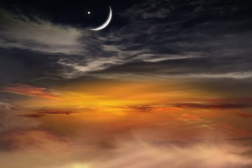 Sunset and new moon . Red sunset and moon . Eid Mubarak background  .  Against the background of clouds .