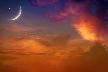 Sunset and new moon .Red sunset and moon . Eid Mubarak background  .