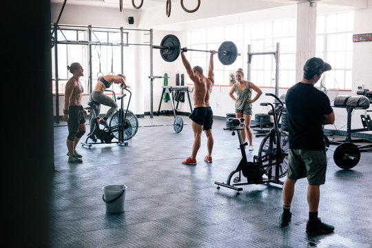 Fitness people doing cross training in gym.